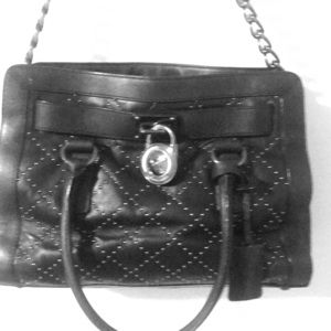 Beautiful studded Michael Kors purse with lock.